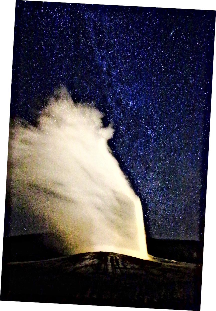 Old Faithful Erupting under the Milky Way