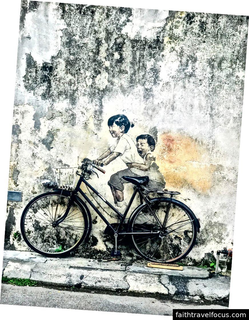 Två barn på cykel av Ernest Zacharevic