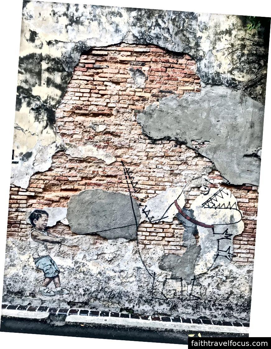 Liten pojke med djurdynosaur. Konst av Ernest Zacharevic
