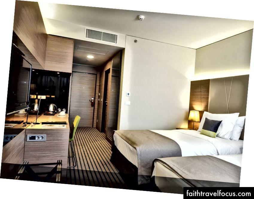 Radisson Blu Plaza Hotel'de yatak odalı konaklama