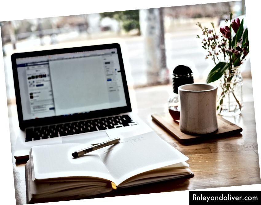 """""""MacBook Pro near white open book"""" av Nick Morrison på Unsplash"""