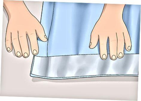 Поставяне на куките в завесата