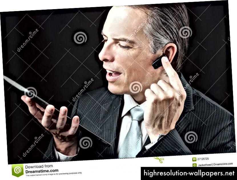 """""""Fortrolig forretningsmand med trådløst headset"""""""