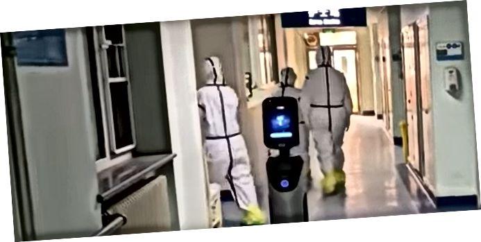 Bild: Robot samlar matbricka från isoleringsavdelningen på ett kinesiskt sjukhus