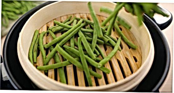 Cozinhar feijão verde fresco