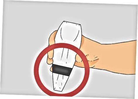 Utilitzant un airejador de mà