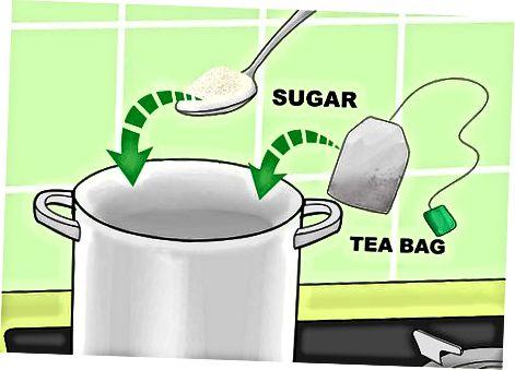 Blanding av te og flaske Kombucha