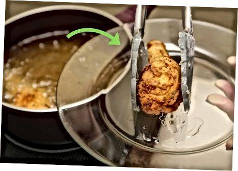De kip frituren