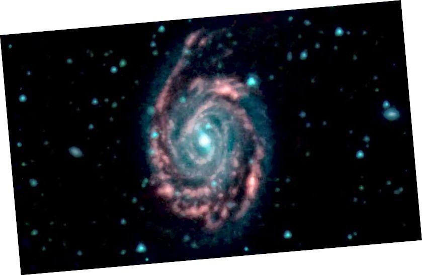 Hauptbild: Die Fusion zweier Galaxien, bekannt als NGC 7752 (größer) und NGC 7753 (kleiner), auch Arp86 genannt. In diesen Bildern entsprechen unterschiedliche Farben unterschiedlichen Wellenlängen des Infrarotlichts. Blau und Grün sind Wellenlängen, die beide stark von Sternen emittiert werden. Rot ist eine Wellenlänge, die hauptsächlich von Staub emittiert wird. Bildnachweis: NASA / JPL-Caltech
