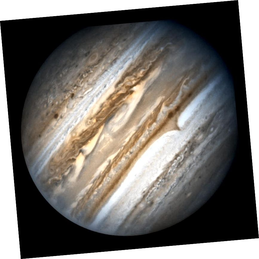 Юпітэр і яго актыўная паласная воблачная сістэма. Малюнак: NASA, ESA і каманда па спадчыне Хабла (AURA / STScI).