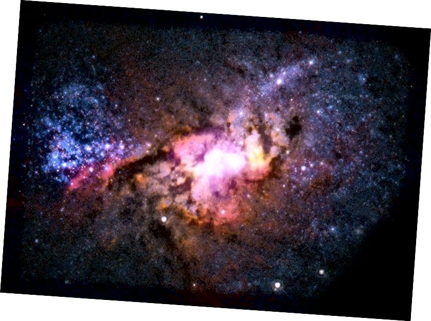 Галяктыка зорных выбухаў Генісі 2–10, размешчаная ў 30 мільёнах светлавых гадоў. Малюнак: рэнтген (NASA / CXC / Virginia / A.Reines і інш.); Радыё (NRAO / AUI / NSF); Аптычны (NASA / STScI).