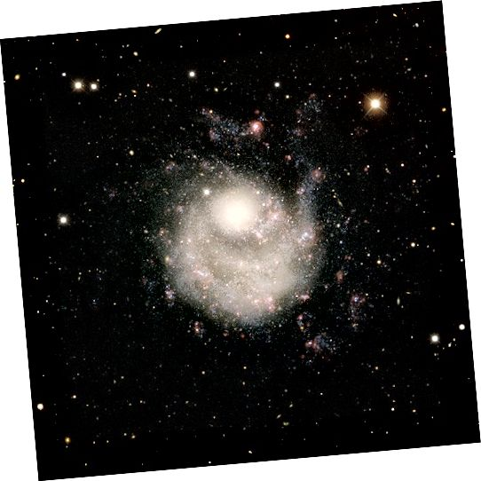 NGC 5474: Réaltra Dwarf i Mór-réaltbhuíon Ursa. Creidmheas Íomhá: ESA / Hubble & NASA
