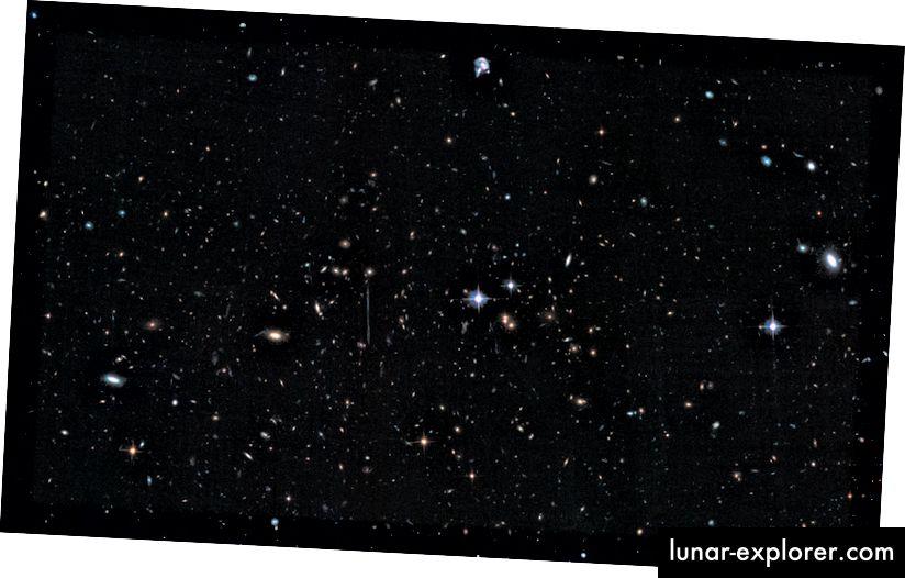 """Das Licht des Galaxienhaufens """"El Gordo"""", ACT-CL J0102–4915, wird seit über 7 Milliarden Jahren genutzt. Bei über 3 Billiarden Sonnen ist es unglaublich massiv, aber die riesigen Ellipsen sind bereits geformt und viel leiser und voller älterer Sterne, als ein """"neuer"""" Sternhaufen vermuten lässt. Bildnachweis: NASA, ESA, J. Jee (Universität von Kalifornien, Davis), J. Hughes (Rutgers University), F. Menanteau (Rutgers University und Universität von Illinois, Urbana-Champaign), C. Sifon (Leiden Observatory), R. Mandelbum (Carnegie Mellon University), L. Barrientos (Universidad Catolica de Chile) und K. Ng (Universität von Kalifornien, Davis)."""