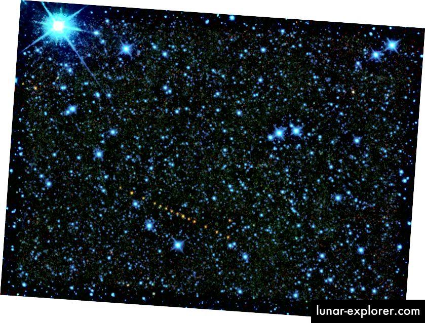 Това е колекция от изображения от космическия кораб WISE на астероида 2305 King, който е кръстен на Мартин Лутър Кинг-младши Астероидът се появява като низ от оранжеви точки, защото това е набор от експозиции, които са добавени заедно, за да покажат движението си през небето. Тези инфрачервени снимки са цветно кодирани, така че да можем да ги възприемаме с човешкото око: 3,4 микрона са представени като сини; 4.6 микрона е зелено, 12 микрона е жълто, а 22 микрона са показани като червени. От данните на WISE можем да изчислим, че астероидът е с диаметър около 12,7 километра, с 22% отразяване, което показва вероятна камениста композиция (НАСА)