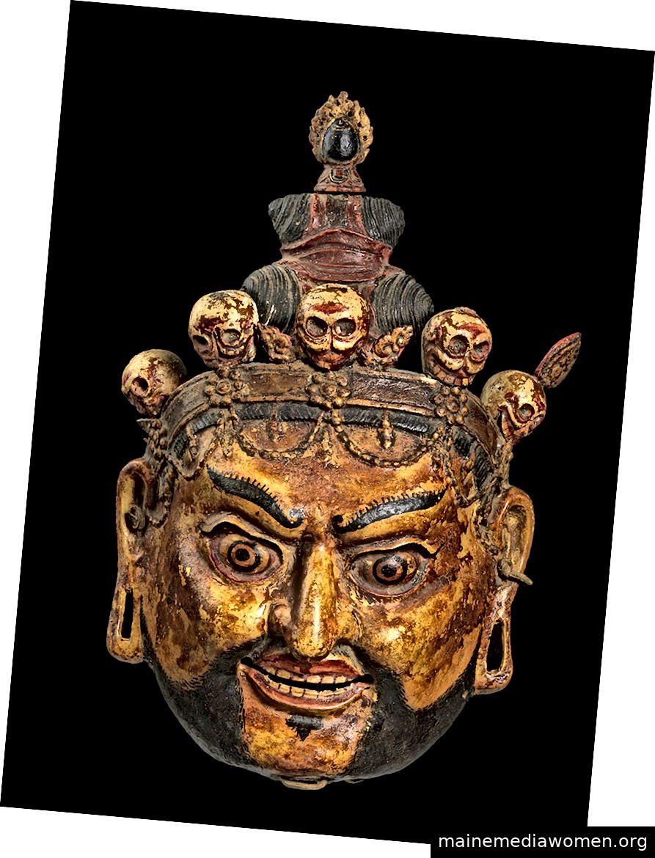 Rituelle Tanzmaske von Padmasambhava als Nyima Ozer (Eine der acht Manifestationen von Guru Rinpoche). Bhutan; Ca. 18. – 19. Jahrhundert. Pappmaché und Pigment, Leder. | Mit freundlicher Genehmigung der Bruce Miller Collection