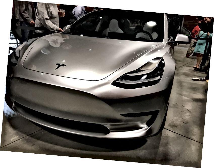 https://www.teslarati.com/wp-content/uploads/2016/11/Silver-Tesla-Model-3-front-employee-party-5.jpg